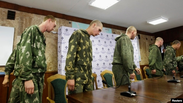 A group of Russian servicemen, who were detained by the Ukrainian authorities in southeastern Ukraine, arrive at a news conference in Kyiv on August 27.