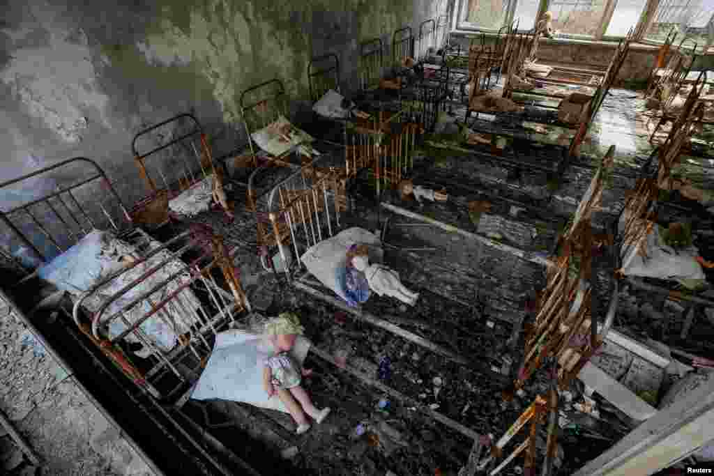 Dolls, which were placed by a visitor, lie in rusty beds at a kindergarten in the abandoned city of Pripyat near the Chernobyl nuclear power plant in Ukraine. (Reuters/Gleb Garanich)