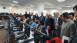 NATO Civilian Representative for Afghanistan Nicholas Kay (2nd R) and British diplomats visited Afghanistan Independent Election Commission National Tally and Data Center to learn about the vote counting prices on October 6.