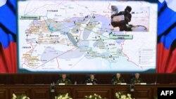 Ռուսաստան - Պաշտպանության նախարարությունում ասուլիսի ժամանակ ներկայացվում է Սիրիայից և Իրաքից Թուրքիա նավթի ապօրինի փոխադրման ուղիների քարտեզը, 2-ը դեկտեմբերի, 2015թ․