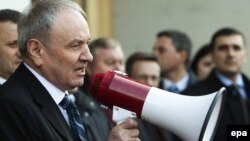 Newly elected President Nicolae Timofti speaks in front of the Republic Palace in Chisinau on March 16.