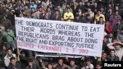 Демонстрация протеста против Башара Асада в Сирии. 2 марта 2012 г
