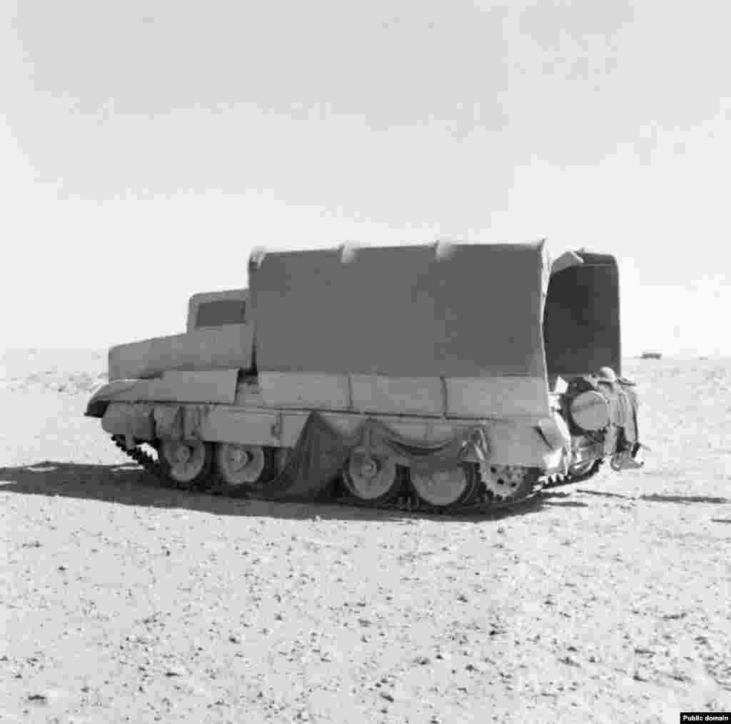 "A British tank dressed as a harmless lorry. In the autumn of 1942, British troops massed phony ""tanks"" at the south of their line and real, disguised fighting vehicles to the north."