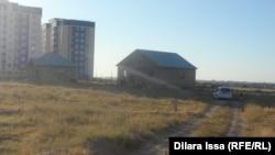 Частные дома возле нового административно-делового центра. Шымкент, 6 июля 2015 года.