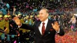 Kazakhstan - FILE PHOTO: Kazakh President Nursultan Nazarbayev waves to supporters after his victory in the presidential election was officially announced in Astana, Kazakhstan December 5, 2005. REUTERS/Stringer/File Photo
