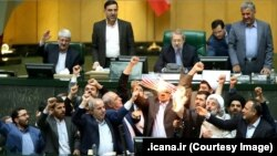 Iranian MPs burning a US flag and a copy of JCPOA in the parliament in Tehran, May 9, 2018