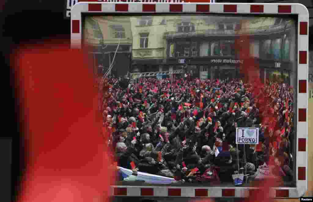 A view in a traffic mirror shows the size of the crowd, who gathered on Narodni trida (National Street), the central boulevard that was the site of the anticommunist protest that sparked the 1989 revolution.