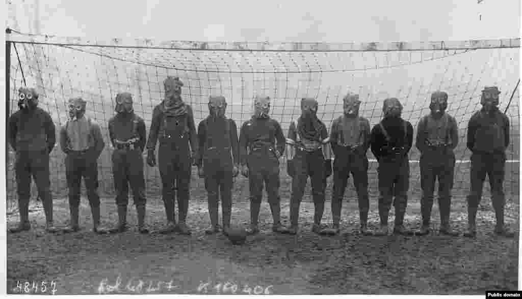 A soccer team of British soldiers dons gas masks during World War I in northern France in 1916.