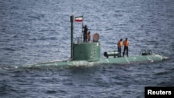 A submarine takes part in the Velayat-90 war games by the Iranian Navy in the Strait of Hormuz in December 2011.