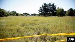 Огороженное поле, где искали останки Джимми Хоффы
