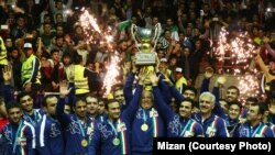 Iranian wrestlers celebrate winning the Freestyle World Cup on home soil on February 17.