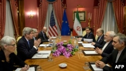 SWITZERLAND-- (From L) US Under Secretary for Political Affairs Wendy Sherman, US Secretary of State John Kerry, US Secretary of Energy Ernest Moniz, Robert Malley, member of the US National Security Council, Iranian Deputy Foreign Minister Abbas Araghchi