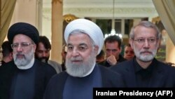 A handout picture provided by the Iranian presidency on September 4, 2019 shows President Hassan Rouhani (Center) before giving a speech after meeting with the Iranian Judiciary chief Ebrahim Raeesi (Left) and parliament speaker Ali Larijani.