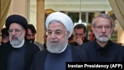 A handout picture provided by the Iranian presidency on September 4, 2019 shows President Hassan Rouhani (Center) before giving a speech after meeting with the Judiciary chief Ebrahim Raeesi (Left) and parliament speaker Ali Larijani (Right)