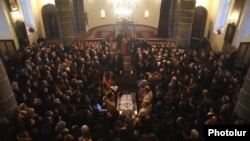 Armenia - A requiem service for 6-month-old Seryozha Avetisian at Gyumri's Surp Nshan Church, 20Jan2015.