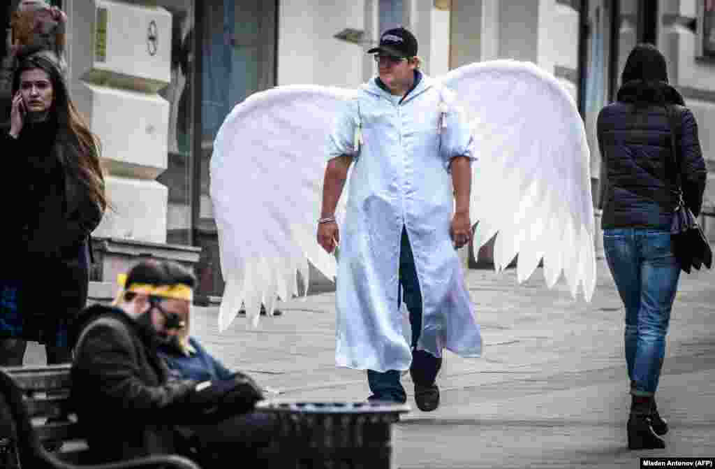 A man with angel wings walks through downtown Moscow in celebration of the Russian Orthodox Easter holiday. (AFP/Mladen Antonov)