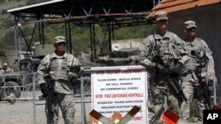 Kosovo -- US soldiers serving in KFOR guard checkpoint in the village of Jarinje, 11Aug2011