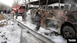 Ukraine--Fire fighters trying to put out blaze on an inter-city bus in the Donetsk Region, eastern Ukraine, 12Feb2009