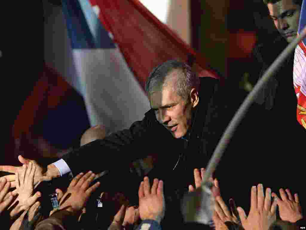 Serbia's election campaign gets under way. - Serbian President and pro-Western Democratic Party (DS) presidential candidate Boris Tadic greets supporters during his final campaign rally in Belgrade, Serbia, on January 31. Tadic was reelected in the February vote.