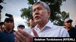 Ex-President Almazbek Atambaev speaks to the media outside his compound in Koi Tash on June 27, 2019.