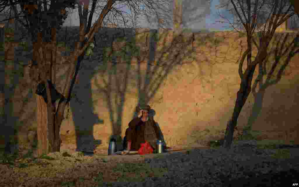 An Afghan farmer drinks tea as he rests after work on the outskirts of Mazar-e Sharif. (AFP/Farshad Usyan)