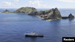 A Japanese survey vessel sails around a group of disputed islands known as the Senkaku in Japan and Diaoyu in China in the East China Sea.