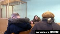 Belarusian artist Henik Loyka (center) at his court hearing in Minsk.