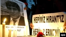 Turkey - Demonstrators have put up candles at the site of the murder of Turkish-Armenian journalist Hrant Dink in Istanbul, 19Jan2007