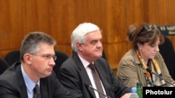 Nigel Mermagen, center, and other members of a Council of Europe observer mission hold a meeting in Armenia.