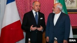 French Foreign Minister Laurent Fabius meets with his Iranian counterpart, Javad Zarif, in Lausanne on March 28.