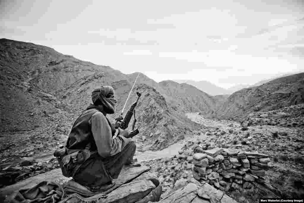 Not far from the strategic Bolan Pass, a member of the Baloch Liberation Army keeps watch.