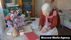An elderly woman casts her vote from home in Moscow's municipal elections on September 10.