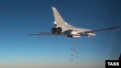 A Russian Tupolev Tu-22M3 long-range bomber drops bombs over Syria in January.