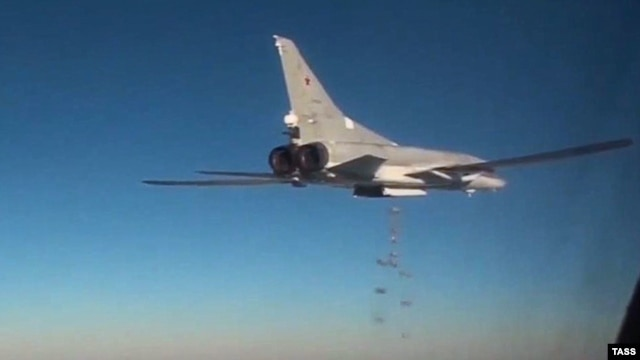 A Russian warplane dropping bombs on positions in Syria.