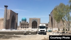 Workers at the construction site for a new amphitheater at the Registan complex in Samarkand.