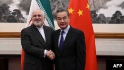 وانگ یی و محمدجواد ظریف، وزیران خارجه چین و ایران