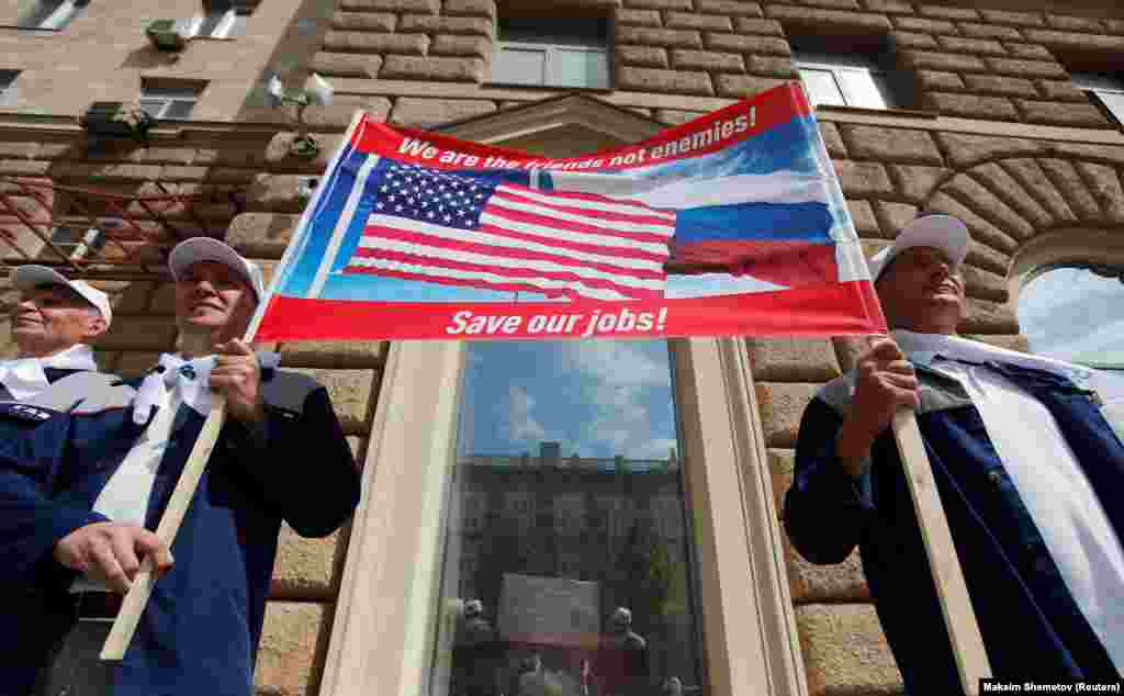 Workers of the Gorkovsky Automobile Plant (GAZ) attend a rally in front of the U.S. Embassy in Moscow on June 10. (Reuters/Maksim Shemetov)