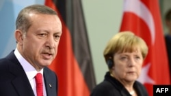 German Chancellor Angela Merkel and Turkish Prime Minister Recep Tayyip Erdogan (file photo)