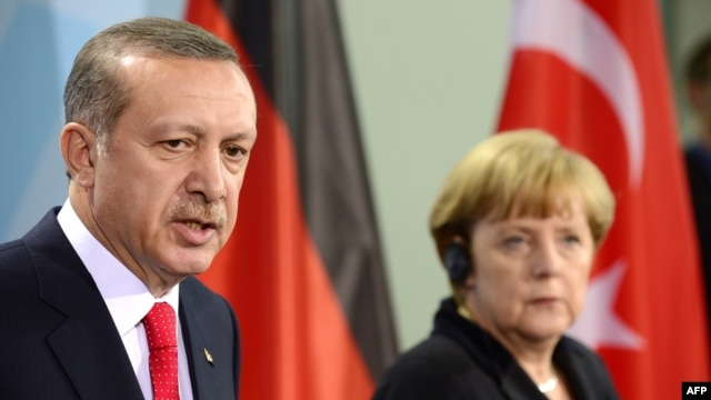 German Chancellor Angela Merkel (right) and Turkish Prime Minister Recep Tayyip Erdogan address a press conference after meeting for talks at the Chancellery in Berlin on October 31.