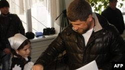 Chechen leader Ramzan Kadyrov casts his vote in Russian parliamentary elections at a polling station in Grozny on December 4.