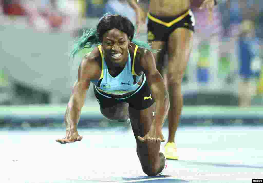 Shaunae Miller of the Bahamas dives over the finish line to win the gold in the women's 400-meter. The dive was a legal move that gave the runner an advantage of a fraction of a second.