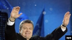 Yanukovych greets supporters during an election rally. He was declared the official winner on February 14.