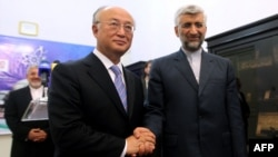 Iran's chief nuclear negotiator Said Jalili (right) with IAEA chief Yukiya Amano in Tehran on May 21.