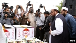 File photo of Hafiz Saeed collecting donations for Falah-e Insaniyat Foundation.