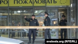 Belarusian police in a cordoned-off area at the Minsk shopping center where the deadly incident took place