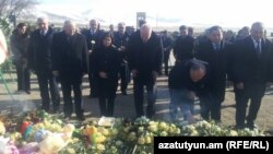 Armenia - Members of the Russian State Duma lay flowers on the graves of the seven members of an Armenian family killed in Gyumri, 23Jan2015.
