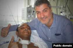 Paolo Macchiarini with Chris Lyle, another patient on whom he performed a trachea transplant in Stockholm in 2011. Lyles died a few months later.