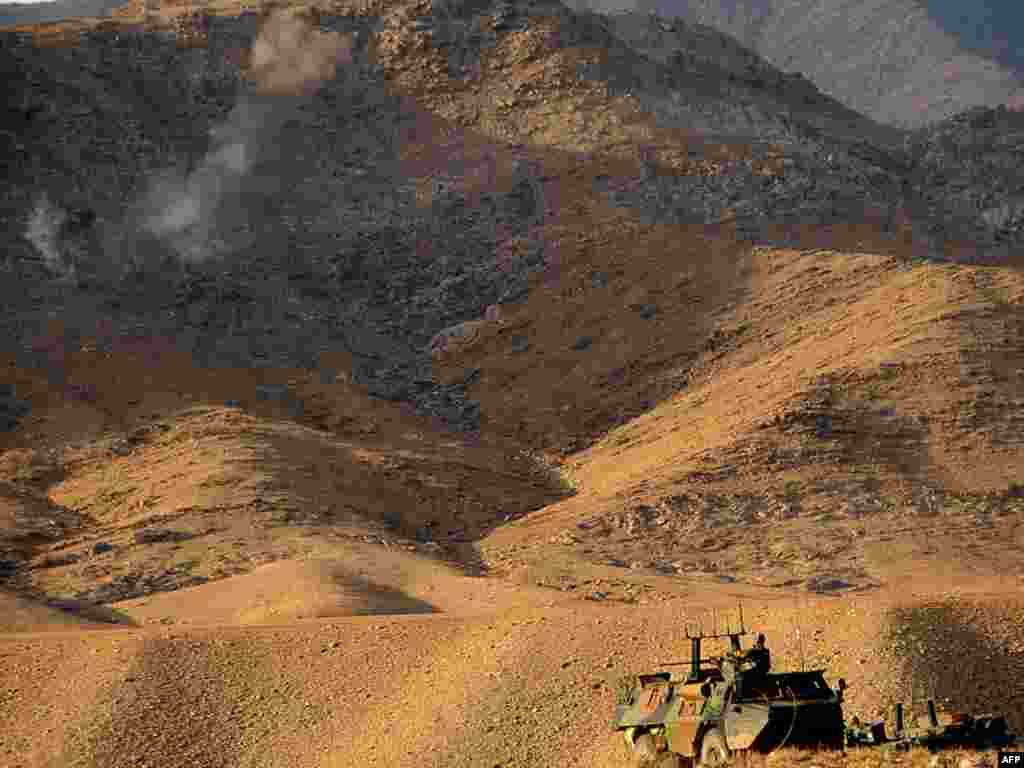 French soldiers in armored vehicles move into position during an operation in Afghanistan. - The French soldiers took part in an operation in Uzbin Valley of Surobi district in Kabul Province on December 17. More than 1,100 soldiers, including 800 French legionnaires as well as U.S. and Afghan commandos, have launched a major operation east of the Afghan capital, military officials said. Photo by Massoud Hossani for AFP