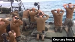 The U.S. Navy fired the commander of 10 sailors who were briefly captured by Iran after straying into Iranian waters in January.
