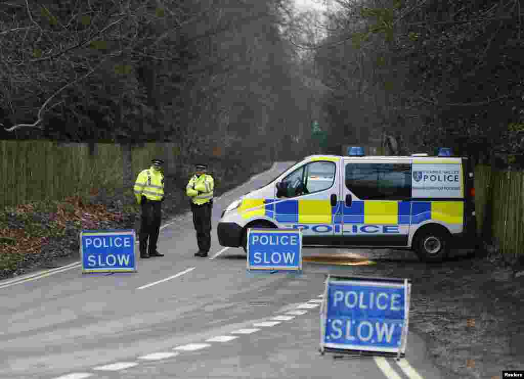A police cordon blocks the road leading to Boris Berezovsky's house after he was found dead at his home near Ascot in Berkshire in as yet unexplained circumstances on March 23, 2013.